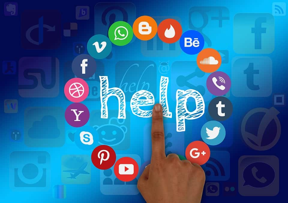 social media logos surround a word say help as someone points to it social media facts
